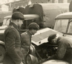 Jan Kurkiewicz (first on the left) in Brest Fortress supervising progress of truck repairing...